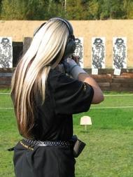 woman shoting at targets