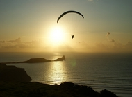 paragliding into the sunset