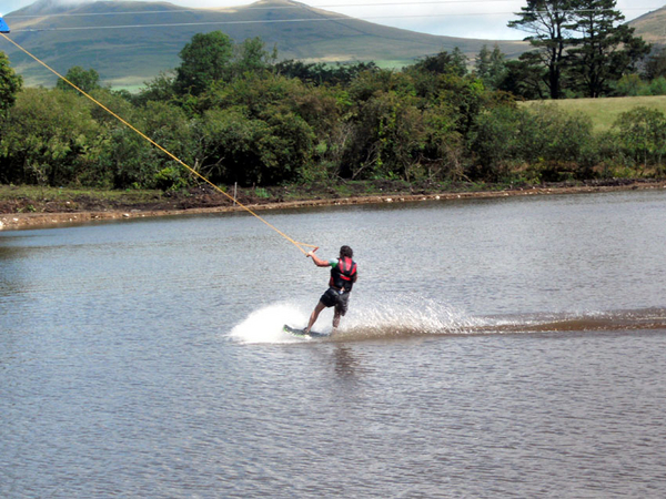 Wakeboarding on a cable tow on a fresh water lake